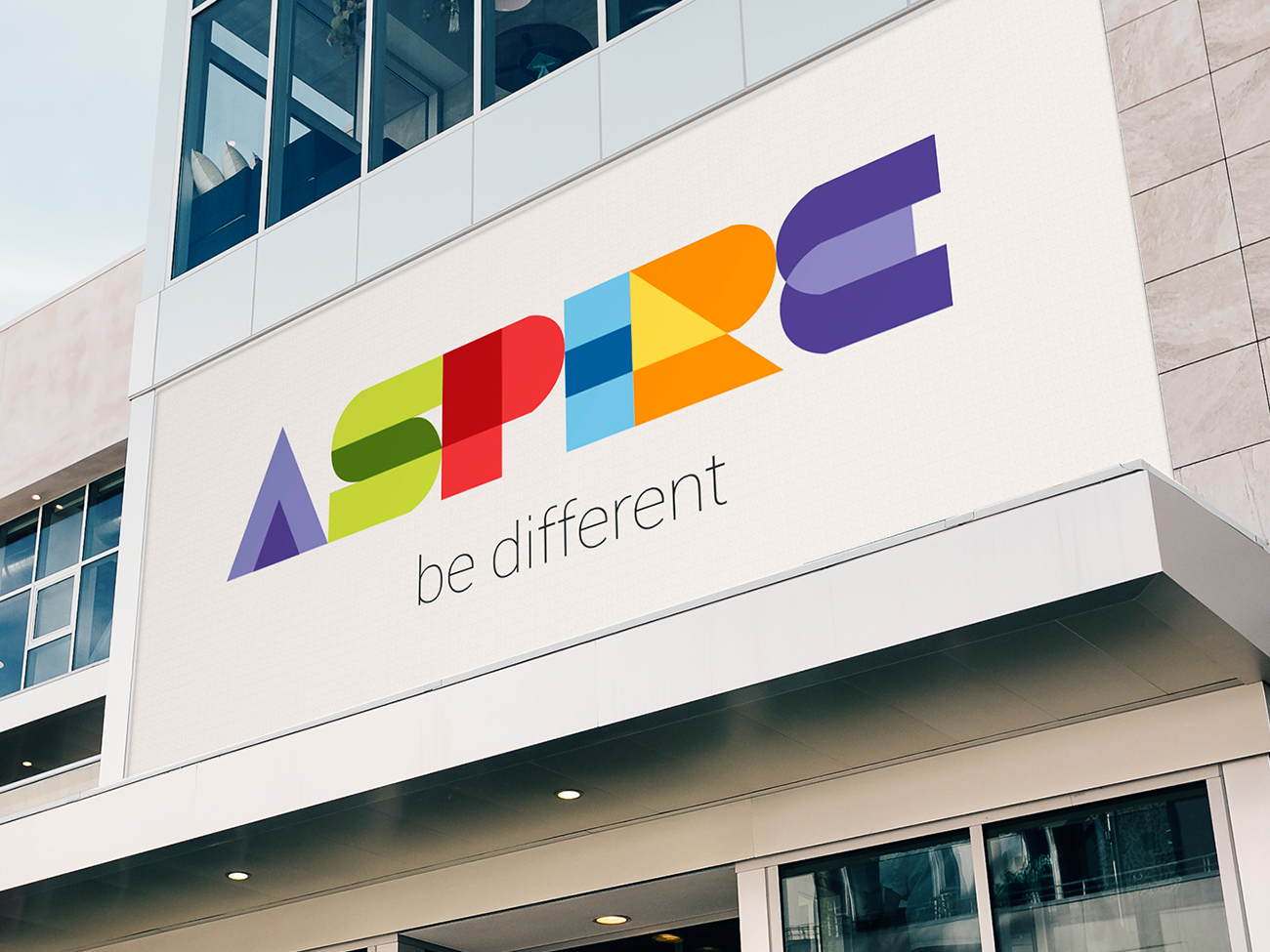 Bright colourful Aspire logo outside an office block
