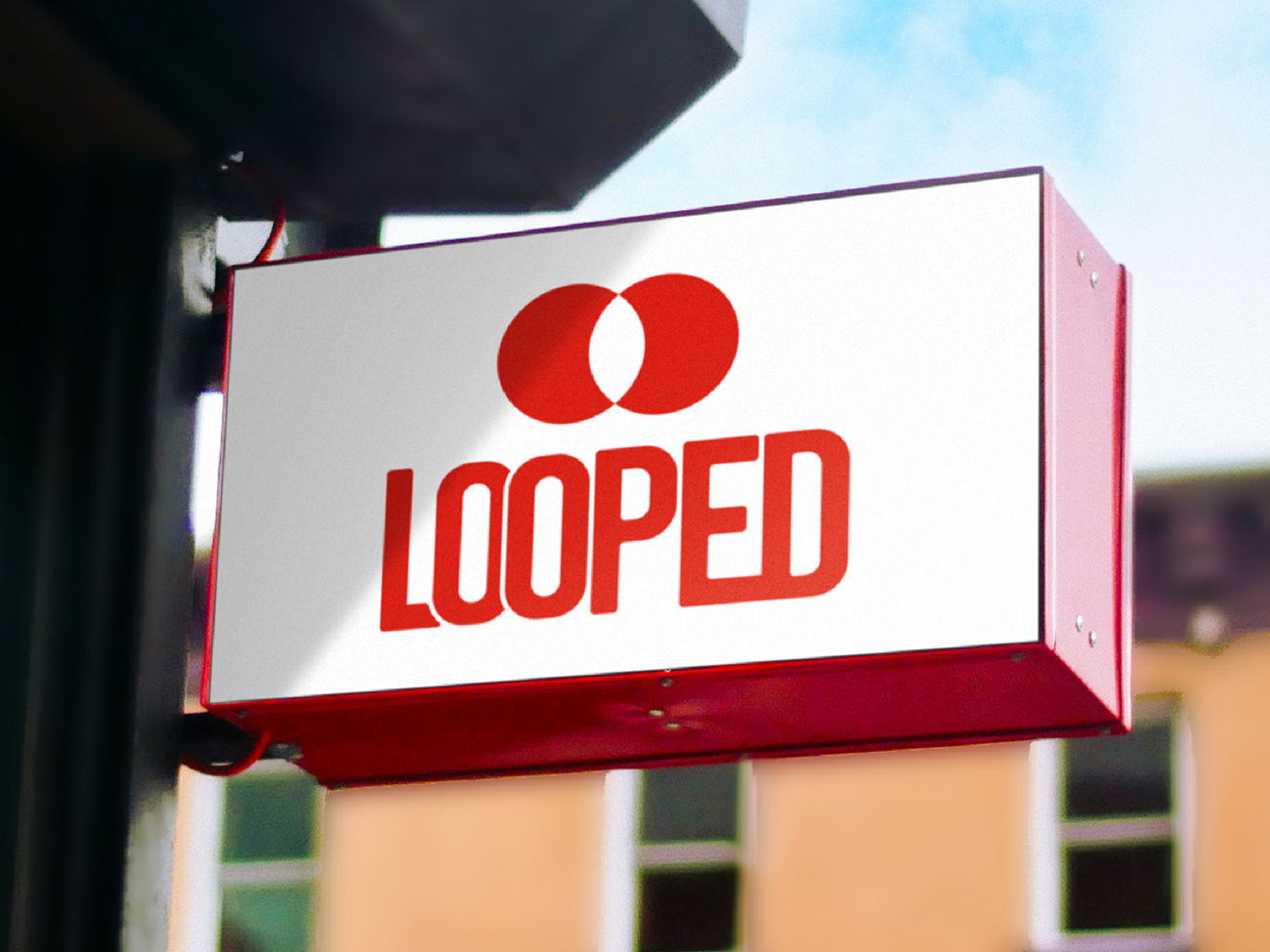Red Looped logo on an outdoor sign of a shop